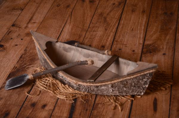 Brown rustic rowboat with oars