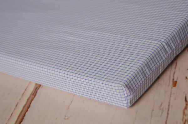 Mattress with blue squared cover