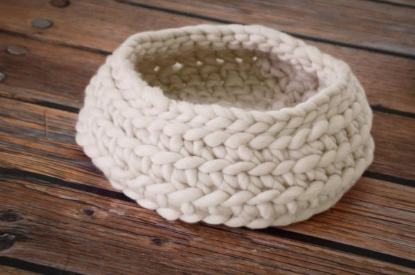 White plaited wool basket
