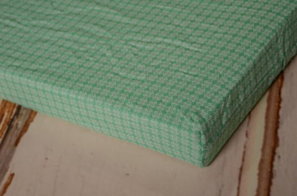 Mattress with green fantasy cover