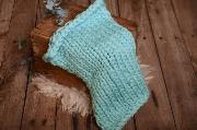 Light blue plaited woollen blanket