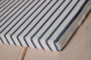 Mattress with blue striped cover